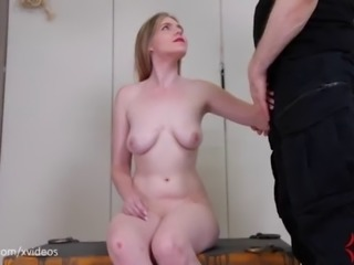 Bruised blond gets fed piss, then hung from her own bandages and fucked in...
