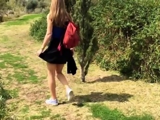 Beautiful young babe takes herself to climax in the outdoors