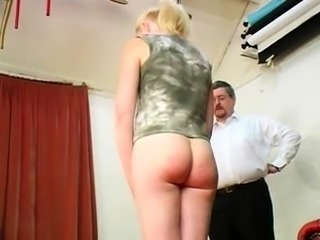 Kinky amateur blonde milf braces herself for a hard spanking