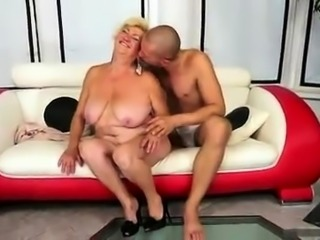 Chunky blonde granny stuffs a young cock inside her snatch