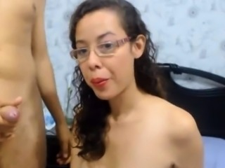 Sexy brunette gives ger bf a footjob and blowjob on webcam
