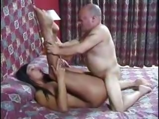 Long-haired brunette chick with a pair of big breasts gets fucked by an old man