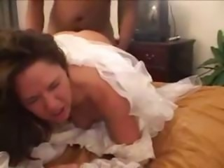 Brunette still in her wedding dress takes on a black cock to fuck