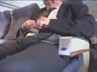 American stewardess gives a asian guy a handjob durning mid flight