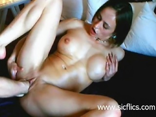 Busty brunette babe double fisted in her bald pussy