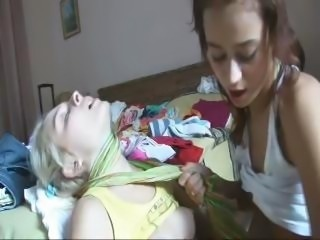 Two cute teen lesbians are rubbing and licking body parts