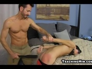 Mature guy spanking and fucking a submissive twinks face