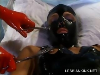 BDSM scene with lesbo getting body toyed
