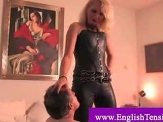 Useless husband humiliated by mistress in leather suite and boots