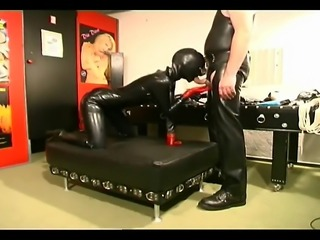 Hot slave girl in latex sucking and fucking a huge black strap on