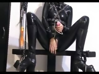 Hottie in latex toying her pussy