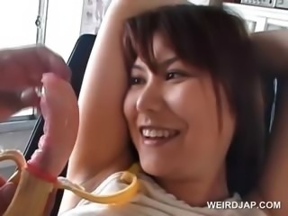 Asian lusty bitch gets hairy snatch toyed in the car