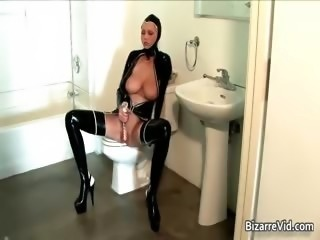 Busty blonde in latex fucking her snatch