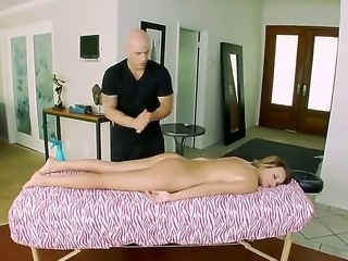 Alexis Adams lies naked on a bench in the anticipation of her massage guy. He...