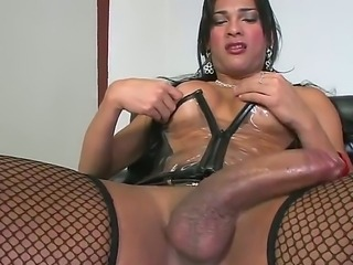 Amazing brunette shemale Jo Garcia with delicious big breasts wanking  huge...