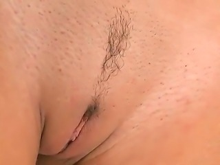 Passionate brunette Serilla Lamante spreads her legs and masturbates with a...