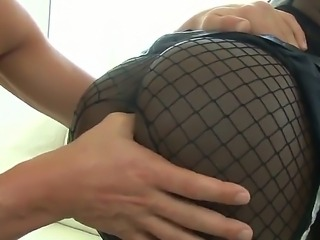 Sexy Bambi Prescott in fishnet stockings is driving Christian XXX crazy with...