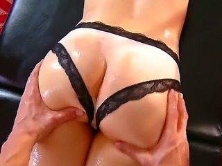 Jenna Ross covers her body with oil for Johnny Sins. It feels goos when he...