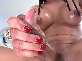 The sympathetic ebony she-male Vanilla with the medium tits masturbates her cock