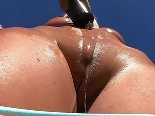 Pretty hot and sexy blonde chick Skylar Price comes out to the backyard and...