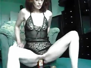 Extreme amateur fucks a whiskey bottle and cucumbers
