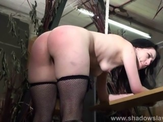 Leather belt spanking and corporal punishment of humiliated brunette spankee...