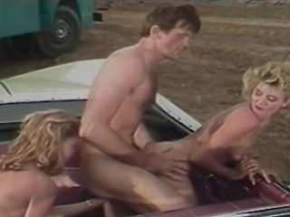 Ginger Lynn and her girlfriend stop at a gas station to ask for help. What...