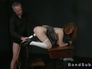Shackled redhead on her all four gets her ass spanked then asshole fucked by...