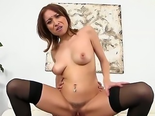 Adessa Winters is a brunette babe in black stockings and shes going to ride...