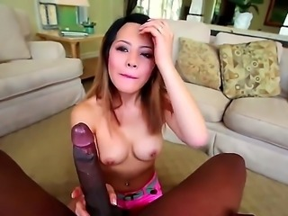 Brunette Asian with a petite figure and a pair of some massive tits is going...