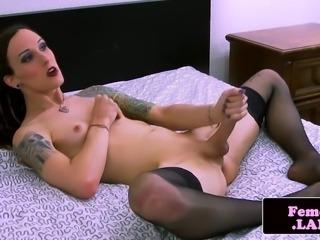 Transitioning femboy jerks dick in stockings