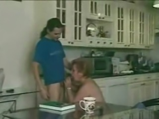 Hairy granny satisfies young boy in the kitchen