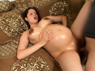 This pregnant nymphomaniac with huge nipples finally gets a cock treat
