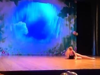 Blonde dancer in a short black dress wiggles her cute booty