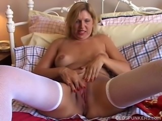 Lovely old spunker in sexy stockings has a nice wank