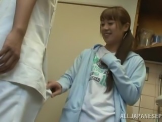 Japanese teen gets fucked doggy style in a bathroom