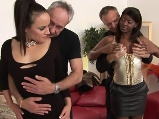 Naughty old men taking part in a thrilling interracial group sex