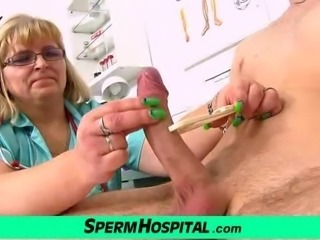 Skinny boy gets a handjob from fat cougar doctor Anna