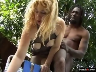 African stud drills dirty asshole of blond head wench outdoors