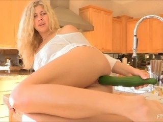 Elegant blonde beauty fucks a veggie into her shaved pussy