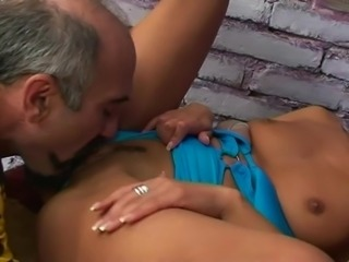 Blacked haired girl gets fucked by older man.