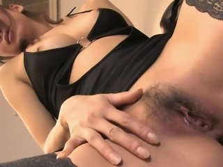 Sexy babe in stockings rubs her pussy lips solo