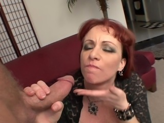 A bad, busty, redheaded MILF uses a younger guy and his hard dick