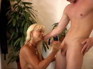 A kinky blonde tosses his salad and sucks his cock