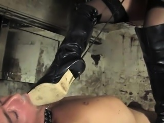 Smoking heeled domina submits her male slave