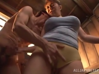 A mature Japanese chick gives a blowjob to a younger guy