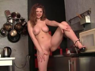 Plump brunette sweetie with big boobies masturbates at kitchen