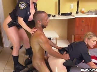 Caucasian police officers fuck black scofflaw in threesome