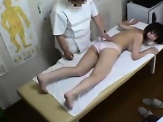 Buxom girl has a masseur working his gifted hands on her sw