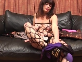 Experienced chick in fishnet clothes and her love for the pink dildo